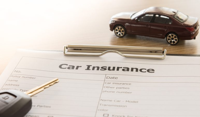 Gill Insurance   car insurance application form with car model and key remote on desk.