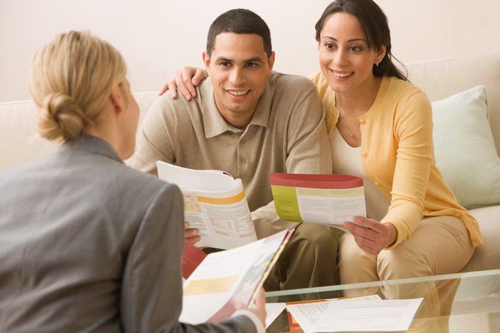 Gill Insurance | Hispanic couple receiving financial consultation